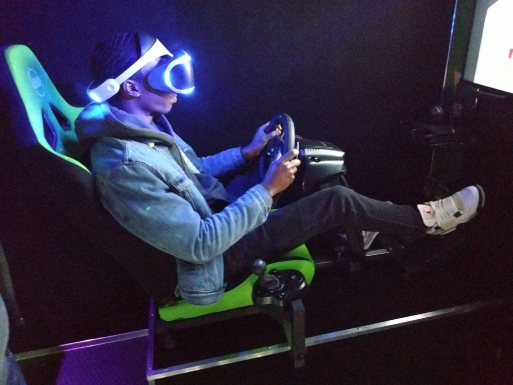 Virtual Reality racing simulator at Middle Georgia video game birthday party